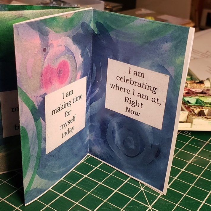 "Image from self-care mini-zine by Kelly Wolf, Open Heart Arts. Text of page reads: ""I am celebrating where I am Right Now."""